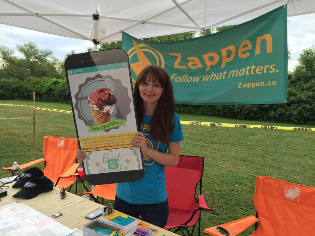 Intern Dominique at the Zappen Booth